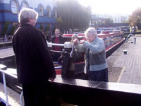 Giles Higgitt instructing how to operate a paddle on a lock